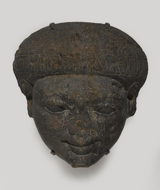 <em>Face from the Lid of a Sarcophagus</em>, ca. 1336-1250 B.C.E. Sandstone, 18 × 17 × 5 in. (45.7 × 43.2 × 12.7 cm). Brooklyn Museum, Charles Edwin Wilbour Fund, 85.166. Creative Commons-BY (Photo: , 85.166_PS9.jpg)