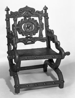 Asante. <em>Chair (Akonkromfi)</em>, 19th century. Wood, copper alloy, leather, 32 1/2 x 23 x 27 in.  (82.6 x 58.4 x 68.6 cm). Brooklyn Museum, Purchased with funds given by Marcia and John  Friede, Dr. and Mrs. Abbott A. Lippman, Mr. and Mrs. Milton F. Rosenthal and Carll H. de Silver Fund, 85.200.2. Creative Commons-BY (Photo: Brooklyn Museum, 85.200.2_bw.jpg)
