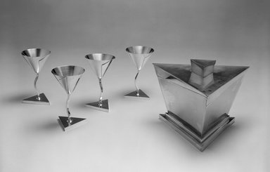 Elsa Tennhardt (American, born Germany, 1899-1980). <em>Stem Glass, Part of Five-piece Set</em>, Patented 1928. Silver-plated brass, 4 7/8 x 2 3/4 x 2 3/4 in. (12.4 x 7 x 7 cm). Brooklyn Museum, Designated Purchase Fund, 85.213.4. Creative Commons-BY (Photo: , 85.213.2a-b-.6_bw.jpg)