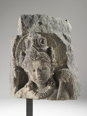 <em>Avalokiteshvara</em>, 9th century. Volcanic stone sculpture, 12 × 11 1/4 × 9 3/4 in., 43 lb. (30.5 × 28.6 × 24.8 cm, 19.5kg). Brooklyn Museum, Gift of Georgia and Michael de Havenon, 85.215.4. Creative Commons-BY (Photo: Brooklyn Museum, 85.215.4_front_PS6.jpg)