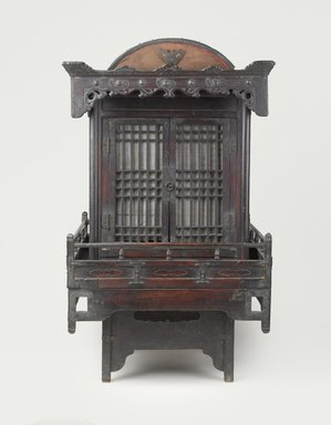 <em>Funerary Sedan Chair</em>, 19th century. Wood, metal, paper, 34 1/2 x 20 1/2 x 25 1/4 in.  (87.6 x 52.1 x 64.1 cm). Brooklyn Museum, Designated Purchase Fund, 85.224. Creative Commons-BY (Photo: Brooklyn Museum, 85.224_front_doors_closed_PS9.jpg)