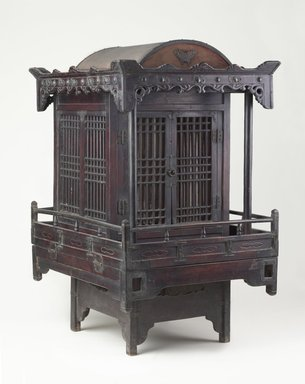 <em>Funerary Sedan Chair</em>, 19th century. Wood, metal, paper, 34 1/2 x 20 1/2 x 25 1/4 in.  (87.6 x 52.1 x 64.1 cm). Brooklyn Museum, Designated Purchase Fund, 85.224. Creative Commons-BY (Photo: Brooklyn Museum, 85.224_threequarter_PS9.jpg)
