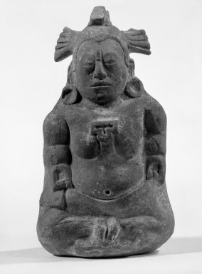 Maya. <em>Seated Priest (Whistle)</em>, 300-900. Clay, pigment, 5 9/16 x 3 1/2 x 3 1/4 in. (14.1 x 8.9 x 8.3 cm). Brooklyn Museum, Gift of Frederic Zeller, 85.262.2. Creative Commons-BY (Photo: Brooklyn Museum, 85.262.2_bw.jpg)