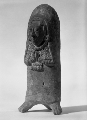 Maya. <em>Woman with Folded Hands (Whistle)</em>, 300-800. Clay, traces of paint, 6 1/2 × 2 3/4 × 2 1/4 in. (16.5 × 7 × 5.7 cm). Brooklyn Museum, Gift of Frederic Zeller, 85.262.4. Creative Commons-BY (Photo: Brooklyn Museum, 85.262.4_bw.jpg)