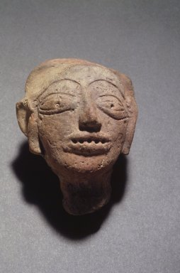 <em>Head of a Male</em>. Red terracotta, 3 11/16 x 3 1/8 x 1 5/16 in. (9.3 x 7.9 x 3.3 cm). Brooklyn Museum, Gift of Dr. Bertram H. Schaffner, 85.283.4. Creative Commons-BY (Photo: Brooklyn Museum, 85.283.4.jpg)