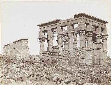 Antonio Beato (Italian and British, ca. 1825-ca.1903). <em>Philae (View of the southeast of the Kiosk of Trajan and the First Pylon of the Temple of Isis)</em>, late 19th century. Albumen silver photograph, image/sheet: 7 3/4 x 10 1/4 in. (19.7 x 26 cm). Brooklyn Museum, Gift of Matthew Dontzin, 85.305.14 (Photo: Brooklyn Museum, 85.305.14_PS4.jpg)