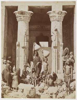 Pascal Sébah (Turkish, 1823-1886). <em>A Group of Egyptians in Front of the Temple of Dendera (Dendur)</em>, late 19th century. Albumen silver photograph Brooklyn Museum, Gift of Matthew Dontzin, 85.305.25 (Photo: Brooklyn Museum, 85.305.25_PS9.jpg)