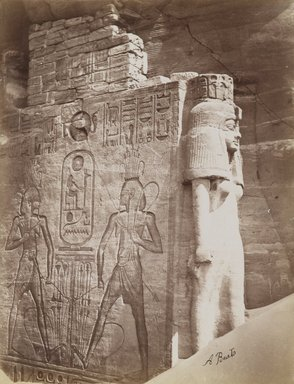 Antonio Beato (Italian and British, ca. 1825-ca.1903). <em>Queen Nefetari at Temple of Abu Simbel (View of detail of throne and queen below the seated Colossus of Ramsses II at the north side of the entrance to the South Temple)</em>, late 19th century. Albumen silver photograph, image/sheet: 7 3/4 x 10 1/4 in. (19.7 x 26 cm). Brooklyn Museum, Gift of Matthew Dontzin, 85.305.5 (Photo: Brooklyn Museum, 85.305.5_PS4.jpg)