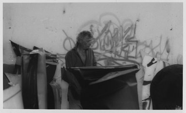 Lenore Seroka (American, born 1935). <em>John Chamberlain</em>, 1980. Gelatin silver photograph, sheet: 11 x 14 in. (27.8 x 35.5 cm). Brooklyn Museum, Gift of the artist, 85.63.4. © artist or artist's estate (Photo: Brooklyn Museum, 85.63.4_PS9.jpg)