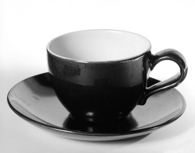 Eva Zeisel (American, born Hungary, 1906-2011). <em>Cup and Saucer</em>, designed ca. 1945; produced ca. 1946. Glazed earthenware, Cup: 2 5/8 x 5 1/8 x 3 3/4 in. (6.7 x 13 x 9.5 cm). Brooklyn Museum, Gift of Eva Zeisel, 85.75.16a-b. Creative Commons-BY (Photo: Brooklyn Museum, 85.75.16a-b_bw.jpg)