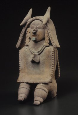 Jama Coaque. <em>Seated Figure</em>, 500 B.C.E.-500 C.E. Clay, paint, slip, 13 x 6 3/4 in.  (33.0 x 17.1 cm). Brooklyn Museum, Gift of Jonathan, Peter, and Timothy Zorach, 86.107.10. Creative Commons-BY (Photo: Brooklyn Museum, 86.107.10.jpg)