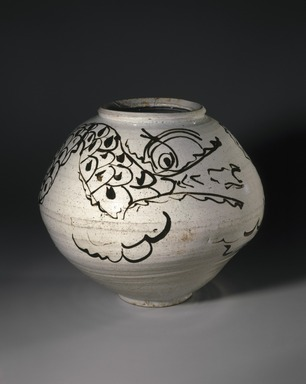 <em>Dragon Jar</em>, mid 17th century. Porcelain with iron-painted decoration under clear glaze, overall: 12 11/16 x 14 9/16 in. (32.2 x 37 cm). Brooklyn Museum, Gift of the Asian Art Council, 86.139. Creative Commons-BY (Photo: Brooklyn Museum, 86.139_color_corrected_SL1.jpg)