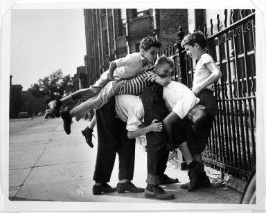 Arthur Leipzig (American, 1918-2014). <em>Johnny on the Pony</em>, 1943. Gelatin silver photograph, sheet: 8 × 10 in. (20.3 × 25.4 cm). Brooklyn Museum, Gift of the artist, 86.152.7. © artist or artist's estate (Photo: Brooklyn Museum, 86.152.7_bw.jpg)