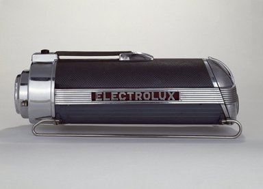 Lurelle Guild (American, 1898-1985). <em>Vacuum Cleaner</em>, ca. 1937. Chromed, polished and enameled steel; cast aluminum; vinyl; rubber, 8 1/2 x 23 x 7 3/4 in.  (21.6 x 58.4 x 19.7 cm). Brooklyn Museum, Gift of Fifty/50, 86.15a-f. Creative Commons-BY (Photo: Brooklyn Museum, 86.15a-f_SL3.jpg)