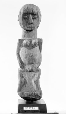Fon. <em>House Guardian Figure (Bochio)</em>, late 19th or early 20th century. Wood, 25 x 7 in. (63.5 x 17.8 cm). Brooklyn Museum, Gift of Dr. and Mrs. Abbott A. Lippman, 86.162.2. Creative Commons-BY (Photo: Brooklyn Museum, 86.162.2_front_bw.jpg)