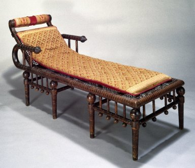 George Jacob Hunzinger (American, born Germany, 1835-1898). <em>Daybed</em>, Patented April 28, 1876. Maple and cloth-covered metal strips, late 19th century English textile applied to head rest and used to make cushion on bed., 31 x 25 x 66 in. (78.7 x 63.5 x 167.6 cm). Brooklyn Museum, Gift of Bruce Newman, 86.177. Creative Commons-BY (Photo: Brooklyn Museum, 86.177_IMLS_SL2.jpg)