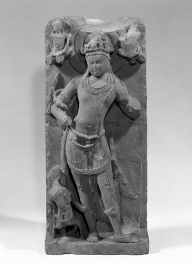 <em>Standing Deity, probably Yama</em>, ca. 800 C.E. Sandstone relief, 44 x 19 in. (111.8 x 48.3 cm). Brooklyn Museum, Gift of Georgia and Michael de Havenon, 86.183.3. Creative Commons-BY (Photo: Brooklyn Museum, 86.183.3_bw.jpg)
