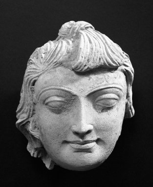 <em>Head of a Male Youth</em>, 4th century or earlier. Stucco with traces of polychrome, 7 x 5 1/16 in. (17.8 x 12.9 cm). Brooklyn Museum, Gift of Georgia and Michael de Havenon, 86.183.6. Creative Commons-BY (Photo: Brooklyn Museum, 86.183.6_bw.jpg)