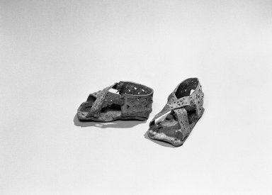 Paracas. <em>Pair of Small Sandals</em>, 300-100 B.C.E. Leather, llama skin, 2 x 2 x 4 in. (5.1 x 5.1 x 10.2 cm). Brooklyn Museum, Gift of the Ernest Erickson Foundation, Inc., 86.224.103a-b. Creative Commons-BY (Photo: Brooklyn Museum, 86.224.103a-b_bw_acetate.jpg)