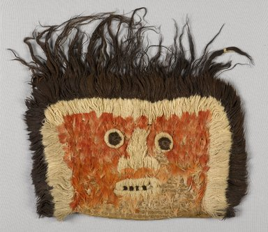 Chimú (?). <em>possible Funerary False Head, Fragment or Mummy Mask</em>, 600-1532. Cotton, camelid fiber, feather, plant leaf, 10 1/4 x 14 15/16in. (26 x 38cm). Brooklyn Museum, Gift of the Ernest Erickson Foundation, Inc., 86.224.123. Creative Commons-BY (Photo: Brooklyn Museum, 86.224.123_PS9.jpg)
