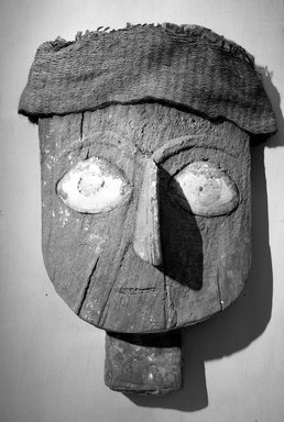 <em>Mask</em>, 1000-1400. Wood, shell, fabric, 12 5/8 x 7 3/8in. (32.1 x 18.7cm). Brooklyn Museum, Gift of the Ernest Erickson Foundation, Inc., 86.224.125. Creative Commons-BY (Photo: Brooklyn Museum, 86.224.125_bw_acetate.jpg)