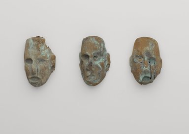 Mississippian. <em>Miniature Mask</em>, 1200-1500. Wood, copper residue, 2 1/4 x 1 7/16in. (5.7 x 3.7cm). Brooklyn Museum, Gift of the Ernest Erickson Foundation, Inc., 86.224.161. Creative Commons-BY (Photo: , 86.224.159_86.224.160_86.224.161_PS9.jpg)