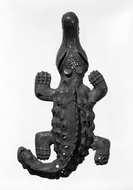 Akan. <em>Sword Ornament in the Form of a Crocodile</em>, late 19th or early 20th century. Copper alloy, 5 1/2 x 2 1/2 in.  (14 x 6.4 cm). Brooklyn Museum, Gift of the Ernest Erickson Foundation, Inc., 86.224.164. Creative Commons-BY (Photo: Brooklyn Museum, 86.224.164_bw.jpg)