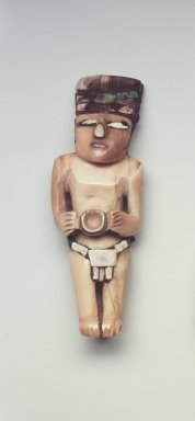 Nazca. <em>Figurine</em>, 300-700 C.E. Ivory, turquois, stone, resin, pigment, 2 1/2 x 1/8 x 3/4 in. (6.4 x 0.3 x 1.9 cm). Brooklyn Museum, Gift of the Ernest Erickson Foundation, Inc., 86.224.195. Creative Commons-BY (Photo: Brooklyn Museum, 86.224.195.jpg)