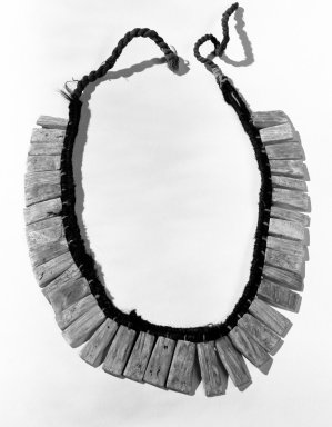 <em>Necklace</em>, before C.E. 1500. Spondylus shell, cotton, wool, Length: 23 3/4 in. Brooklyn Museum, Gift of the Ernest Erickson Foundation, Inc., 86.224.199. Creative Commons-BY (Photo: Brooklyn Museum, 86.224.199_bw_acetate.jpg)