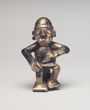 Chimú Inca. <em>Seated Figure with Tweezers</em>, 1400-1532. Hammered gold, 1 7/8 x 1 1/4 in. (4.8 x 3.2 cm). Brooklyn Museum, Gift of the Ernest Erickson Foundation, Inc., 86.224.33. Creative Commons-BY (Photo: Brooklyn Museum, 86.224.33_transp5645.jpg)