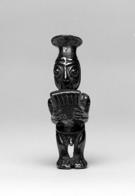 Chimú Inca. <em>Male Figurine Holding Panpipes</em>, before C.E. 1500. Silver, 2 1/16 x 11/16 x 13/16 in. (5.2 x 1.7 x 2.1 cm). Brooklyn Museum, Gift of the Ernest Erickson Foundation, Inc., 86.224.87. Creative Commons-BY (Photo: Brooklyn Museum, 86.224.87_front_bw.jpg)