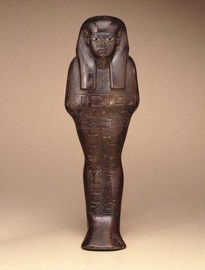 <em>Shabty of the Man Maya</em>, ca. 1390-1352 B.C.E. Wood, pigment, glass, 16 x 3 9/16 x 5 1/2 in. (40.7 x 9 x 14 cm). Brooklyn Museum, Gift of the Ernest Erickson Foundation, Inc., 86.226.21. Creative Commons-BY (Photo: Brooklyn Museum, 86.226.21_SL1.jpg)