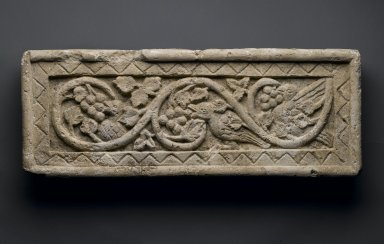 Coptic. <em>Plant Scroll Enclosing Birds and Grapes</em>, 5th-6th century C.E. Limestone, 8 11/16 x 20 3/4 x 2 3/8 in. (22 x 52.7 x 6 cm). Brooklyn Museum, Gift of the Ernest Erickson Foundation, Inc., 86.226.27. Creative Commons-BY (Photo: Brooklyn Museum, 86.226.27_PS1.jpg)