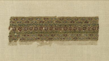 <em>Textile Fragment</em>, early 12th century. Linen ground, silk tapestry-woven decorative band, 3 1/2 x 10 3/8in. (8.9 x 26.4cm). Brooklyn Museum, Gift of the Ernest Erickson Foundation, Inc., 86.227.102. Creative Commons-BY (Photo: Brooklyn Museum, 86.227.102_PS1.jpg)
