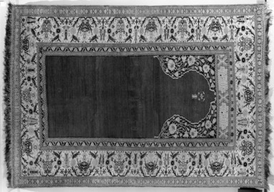 <em>Prayer Rug</em>, 18th century. Wool warp, weft and pile, New Dims 2005: 73 1/2 x 51 in. (186.7 x 129.5 cm). Brooklyn Museum, Gift of the Ernest Erickson Foundation, Inc., 86.227.120. Creative Commons-BY (Photo: Brooklyn Museum, 86.227.120a_overall_acetate_bw.jpg)