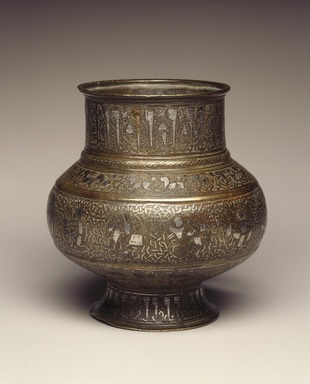 <em>Jug (Mashraba) with Human-Headed Inscription and Zodiac Signs</em>, late 12th-early 13th century. Copper alloy, engraved, inlaid and overlaid with silver, height: 5 1/2 in. (14 cm). Brooklyn Museum, Gift of the Ernest Erickson Foundation, Inc., 86.227.123. Creative Commons-BY (Photo: Brooklyn Museum, 86.227.123_SL1.jpg)