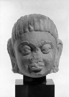 <em>Head of a Male</em>, 1st-2nd century. Red-gray sandstone, 6 1/2 x 5 1/8 x 5 7/8 in. (16.5 x 13 x 15 cm). Brooklyn Museum, Gift of the Ernest Erickson Foundation, Inc., 86.227.135. Creative Commons-BY (Photo: Brooklyn Museum, 86.227.135a_front_acetate_bw.jpg)