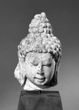 Mon. <em>Head of a Buddha</em>, 8th-9th century. Stucco, 5 3/4 x 3 1/2in. (14.6 x 8.9cm). Brooklyn Museum, Gift of the Ernest Erickson Foundation, Inc., 86.227.156. Creative Commons-BY (Photo: Brooklyn Museum, 86.227.156_acetate_bw.jpg)