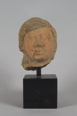 <em>Head of a Buddha</em>, 6th century. Red terracotta, 6 1/4 x 4 1/4in. (15.9 x 10.8cm). Brooklyn Museum, Gift of the Ernest Erickson Foundation, Inc., 86.227.170. Creative Commons-BY (Photo: Brooklyn Museum, 86.227.170_PS5.jpg)