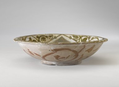 <em>Bowl</em>, 10th-11th century. Ceramic, monochrome lusterware, pink earthenware body, 2 5/8 x 9 5/16 in. (6.6 x 23.7 cm). Brooklyn Museum, Gift of the Ernest Erickson Foundation, Inc., 86.227.187. Creative Commons-BY (Photo: Brooklyn Museum, 86.227.187_side_PS9.jpg)