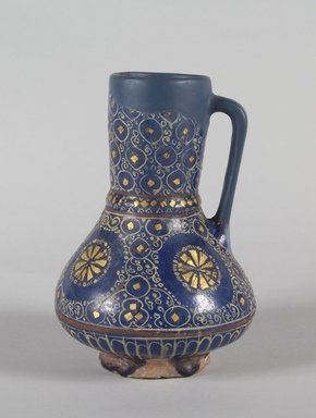 <em>Jug</em>, late 13th-early 14th century. Ceramic, lajvardina ware; fritware, painted in red and white with gold leaf on a cobalt blue glaze, 7 x 4 15/16 in. (17.8 x 12.5 cm). Brooklyn Museum, Gift of the Ernest Erickson Foundation, Inc., 86.227.195. Creative Commons-BY (Photo: Brooklyn Museum, 86.227.195_PS5.jpg)