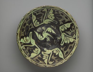 <em>Bowl</em>, 9th-10th century. Ceramic, brown and white slip, transparent colorless glaze, 3 1/8 x 11 in. (7.9 x 28 cm). Brooklyn Museum, Gift of the Ernest Erickson Foundation, Inc., 86.227.21. Creative Commons-BY (Photo: Brooklyn Museum, 86.227.21_PS6.jpg)