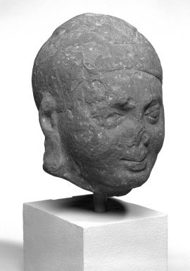 <em>Head</em>, ca. 2nd century. Red sandstone, 8 x 6 x 7 1/16 in. (20.3 x 15.2 x 18 cm). Brooklyn Museum, Gift of the Ernest Erickson Foundation, Inc., 86.227.32. Creative Commons-BY (Photo: Brooklyn Museum, 86.227.32_bw.jpg)