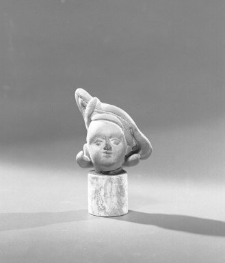 <em>Head</em>, ca. 2nd century. Terracotta, 2 3/16 x 1 15/16 x 1 11/16 in. (5.5 x 5 x 4.3 cm). Brooklyn Museum, Gift of the Ernest Erickson Foundation, Inc., 86.227.33. Creative Commons-BY (Photo: Brooklyn Museum, 86.227.33_acetate_bw.jpg)