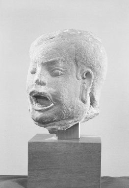 <em>Male Head</em>, late 12th-early 13th century. Gray sandstone, 7 x 5 1/2 x 5 1/2 in. (17.8 x 14 x 14 cm). Brooklyn Museum, Gift of the Ernest Erickson Foundation, Inc., 86.227.39. Creative Commons-BY (Photo: Brooklyn Museum, 86.227.39_acetate_bw.jpg)