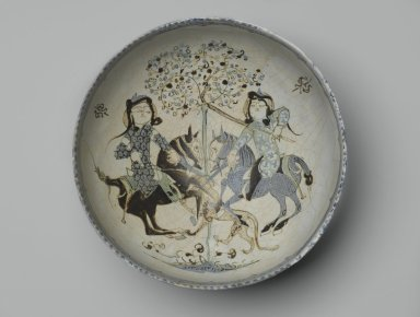 <em>Bowl with Confronted Mounted Horsemen</em>, late 12th-early 13th century. Ceramic, mina'i (enameled) or haft rangi (seven colors) ware; fritware, in-glaze painted in blue, green, and brown on an opaque white glaze, overglaze painted in black, 3 1/2 x 7 1/2 in. (8.9 x 19.1cm). Brooklyn Museum, Gift of the Ernest Erickson Foundation, Inc., 86.227.60. Creative Commons-BY (Photo: Brooklyn Museum, 86.227.60_top_PS2.jpg)