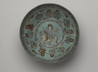 <em>Bowl Depicting a Falconer and Four Pairs of Seated Figures</em>, 12th-13th century. Fritware, covered with a turquoise glaze with in-glaze and overglaze painting in red, green, blue, yellow, black, and gold, 3 11/16 x 8 1/4 in. (9.4 x 21 cm). Brooklyn Museum, Gift of the Ernest Erickson Foundation, Inc., 86.227.65. Creative Commons-BY (Photo: Brooklyn Museum, 86.227.65_top_PS9.jpg)