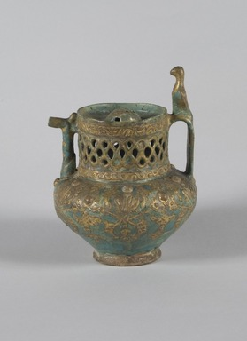 <em>Vase in the Shape of a Pitcher, Lajevardina ware</em>, mid-13th century. Ceramic; fritware, reticulated, molded, and painted in turquoise, red, white with gold-leaf overglaze over an opaque transparent glaze, 7 9/16 x 5 11/16 in. (19.2 x 14.5 cm). Brooklyn Museum, Gift of the Ernest Erickson Foundation, Inc., 86.227.67. Creative Commons-BY (Photo: Brooklyn Museum, 86.227.67_PS5.jpg)