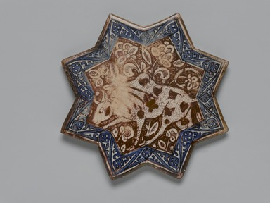 <em>Eight-pointed Star Tile</em>, ca. 1290–91. Ceramic; fritware, painted in cobalt blue and luster on an opaque white glaze, 8 7/16 x 1/2 in. (21.4 x 1.2 cm). Brooklyn Museum, Gift of the Ernest Erickson Foundation, Inc., 86.227.70. Creative Commons-BY (Photo: Brooklyn Museum, 86.227.70_PS2.jpg)