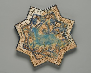 <em>Eight-Pointed Star Tile with a Gazelle</em>, 13th-14th century. Ceramic; fritware, painted in luster and blue over an opaque white glaze, 8 1/4 x 3/8 x 8 1/4 in. (21 x 1 x 21 cm). Brooklyn Museum, Gift of the Ernest Erickson Foundation, Inc., 86.227.71. Creative Commons-BY (Photo: Brooklyn Museum, 86.227.71_PS2.jpg)